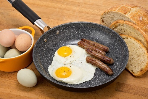 Eggs And Sausages In Pan